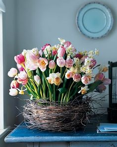 pink daffodills in grapevine basket. Love!