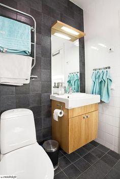 Floating Wooden Vanity Cabinet With Lighting Above Mirror Black Tile Flooring To Wall Minimalist Bathroom Interior Still Looks in Gorgeous Style Bathroom design http://seekayem.com