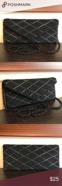 """NWOT Black Beaded Purse Fashion And Beauty Combined To Create This Gorgeous Elegant Purse. Its Simple And Slim Yet Beautiful Beaded Design Makes It A Perfect Choice For Any Special Occasion, Going Out With Friends Or Date Night. Brand New (NWOT) And Never Used. In Excellent Condition.   Details:  Two Interior Pockets  Magnetic Closure  Measurements:  Length 9""""  Height 4"""" Bags Shoulder Bags"""