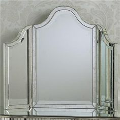 """Tri-fold Channeled Glass Vanity Mirror  Antiqued Tri-fold Mirror. Antiquing all over mirrored surface. Fully Extended (28.5""""H x 35.5"""" W x 1.5"""" D) Each Panel Right and Left (23"""" H x 8.5"""" W x 1.5"""" D)"""
