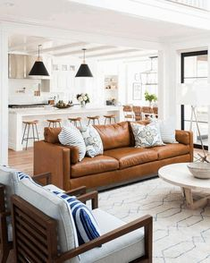 48 Lovely Farmhouse Living Room With Leather Sofa Ideas. Awesome 48 Lovely Farmhouse Living Room With Leather Sofa Ideas. When it comes to choosing a specific style of living room furniture, leather can be a distinct choice among many […] Brown Couch Living Room, Living Room Sofa Design, Family Room Design, Home Living Room, Living Room Designs, Living Room Decor Ideas Brown Sofa, Brown Sofa Decor, Living Room Kitchen Layout, Modern Farmhouse Living Room Decor