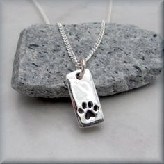 Dog Paw Necklace Sterling Silver Pendant Charm Tag Paw Print Animal Pet Lover, via Etsy.