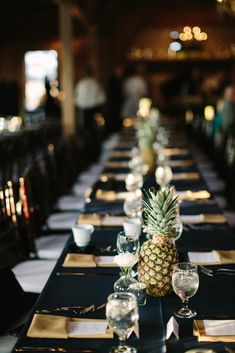 pineapple table setting...we wanted the decor to be minimal and to compliment beautiful Boone Hall; as mentioned in another photo, our total floral costs came to $600 because we kept it simple with pineapples and white mums on the tables and did wildflower style bouquets. Thanks to Ooh Events and Snyder Rentals for the beautiful chairs/chandeliers and linens. { Boone Hall Cotton Dock Wedding