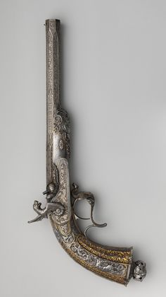 """A presentation model percussion target pistol signed """"Gilles Michel Louis Moutier-Le Page"""", French, mid 19th century."""