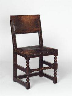 """1660-1700 English Chair at the Victoria and Albert Museum, London - From the curators' comments: """"This kind of chair was known in 17th century Britain as a 'backstool' - literally, a stool with a back attached. It was the standard type of seating - often fitted with textile or leather covers - from 1615 until about 1670, when fashionable chair-backs became higher and the back legs were raked backwards for greater stability."""""""