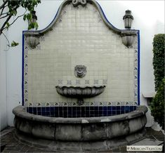 MexicanTiles.com - Exterior Fountain with Humming Bird, Blue Marguerite Accents and Mexican White Solid Mexican Talavera Tile