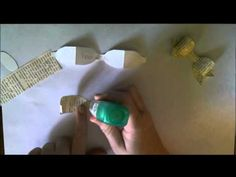 tutorial on how to make a cute bow with a paper strip.