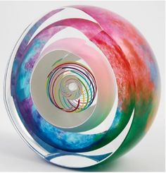 Ship in 2-3 weeks Blown layered glass sculptural paperweight with precision stripes inside, white and multicolor outside with clear layers in between. After blowing the piece is cooled and then cold w