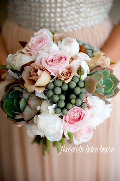 Charming wedding bouquet with lush roses and succulents   Floral Design by Flowers By Helen Brown.