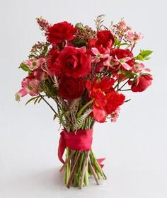 Orange and Red Wedding Flowers | Find the perfect bouquet to match your warm wedding palette.
