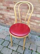 Described as a beech wood banqueting chair, This chair is a classic bent wood chair in gold.