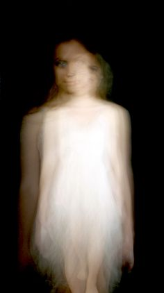 A slow shutter speed with a person moving in the dark with a small source of light.