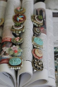 Roll the pages of books to create slots to display rings. This is also a great technique for displaying note cards or earring cards. Jewelry
