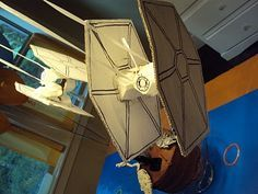 tie fighter out of cardboard and egg carton...the deathstar could be an old globe painted instead of paper mache