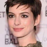 Anne Hathaway Short Haircut: Brown Elfin Pixie Cut with Long Side Piecey Bangs