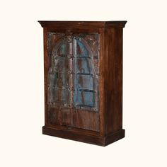 """Drawing inspiration from the western border towns, the Willamette 33"""" Arched Door Rustic Blue Accent Armoire Storage Cabinet invokes images of ages past throughout the American frontier. Great arched doors recall centuries-old architecture, doorways, and windows. Reclaimed materials, natural wood grain, hand-carved details, and a hand-applied finish all combine to create a piece that is a true representation of reclaimed, rustic furniture."""