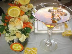 What would a Martini Party be without a large martini glass with floating candles?