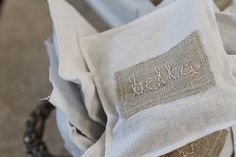 french vintage cream and white baby shower personalized lavender sachets with baby bella's name on them