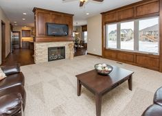 Traditional Great Room with stone fireplace, Ceiling fan, Carpet
