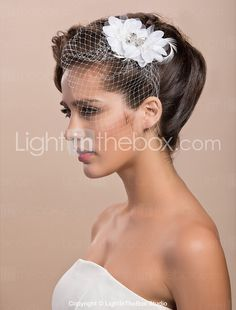 I would alter this Tulle Wedding Bridal White Feather Rhinestone Headpiece - USD $ 14.54