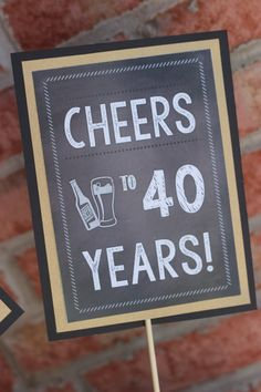Chalkboard 40th Birthday centerpiece. Set by CharmingTouchParties