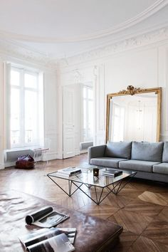 """House tour: a pared-back 19th-century apartment in Paris : They don't eat at the dining table, for instance; they like the coffee table better. They designed a coat rack made of metal pipes. And their bedhead is a repurposed 1950s leather gym mat. """"We found these three mats in a flea market in the south of France,"""" Sauzay recalls. """"They had been recovered from a school. We thought it would be interesting to change their use, so we made the headboard — it's very warm and soft — and because…"""