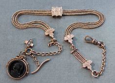 Victorian Watch Chain Necklace with Multiple Fobs and Slides. $345.00, via Etsy.