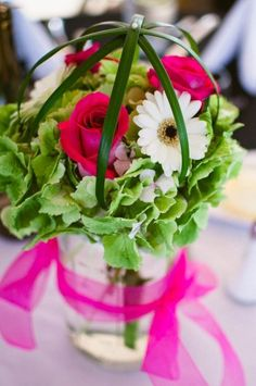 Large mason jar filled with hydrangea, roses and gerbera daisies with criss crossed lily grass $64.99