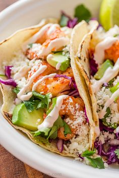 Shrimp Tacos are loaded with shrimp, cabbage, avocado, cotija, cilantro and served over gluten free corn tortillas. The shrimp taco sauce will win you over! Shrimp Taco Sauce, Spicy Shrimp Tacos, Shrimp Taco Recipes, Mexican Food Recipes, Ethnic Recipes, Yummy Recipes, Mexican Dishes, Fish Recipes, Keto Recipes