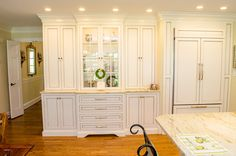 Ultimate Chef's Kitchen with a Double Island Featuring White Cabinets