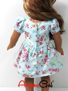 This little dress is perfect for Easter or any special occasion. It features a scoop neckline, puffy princess sleeves, and tiny buttons along a perfectly fitted bodice. The gathered skirt is styled ju