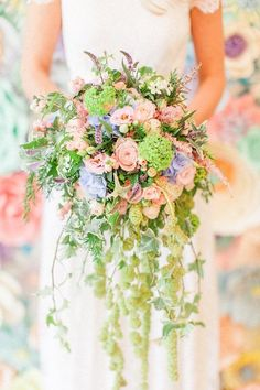 Unicorn inspired waterfall bridal bouquet blush pink roses,  clematis, viburnum with amaranths to add drama