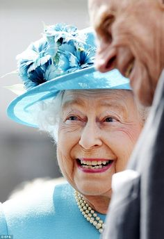 All smiles: The Queen was on top form and smiled broadly as she was introduced to some of the locals. Queen Elizabeth II is smiling.