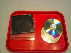 Fine Motor Skills practice for toddlers placing cds inside cases. Good to practice opening and closing.