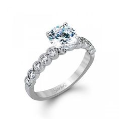 Classically designed yet featuring a modern flair this delicate white gold engagement ring. From $2,662.