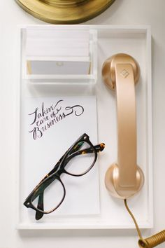 @Danielle Lampert Moss Chicago Home Tour // gold pop phone // Molly Jacques notepad // photography by Stoffer Photography