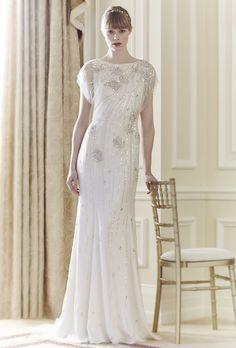 "Brides.com: Jenny Packham - Spring 2014. ""Rose"" beaded tulle sheath with high neckline and illusion short sleeves, Jenny Packham."