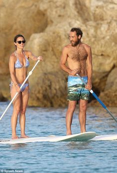 Pippa and James walk along the beach and the close brother and sister board together while having a conversation