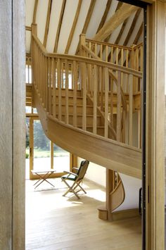 This timber winder staircase looks stunning as you walk through the door and is a real design feature in the room.