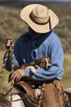 A cowboy and his dog