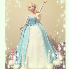 Disney Frozen Elsa doll cake I made using an Elsa doll.  The dress is cake covered with fondant. Javajunko Cakes