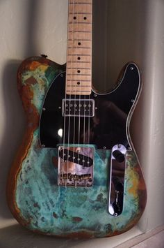 One of a kind Telecaster guitar made with the best parts and finished with an unbelievable oxidized (not painted) multi-color finish from Snowflake Finishes. Check out this feature list:Durable oxidized sunburst body finish in blue-green algae and rust - low sheen, matte, texturedFender-licensed Mighty Mite birdseye maple 21-fret tele neckGFS Surf 90 Alnico II neck pickupFender Tele pickguardJoe Barden vintage ashtray bridgeHarmonic Design Super 90 Tele bridge pickupFender in-line ...