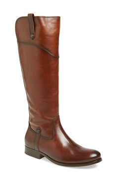 Brown leather knee high boots are a must for fall.
