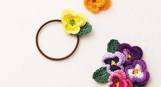 Un élastique fleur pour cheveux au crochet