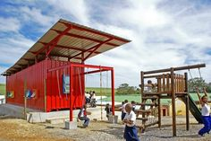 """Tsai Design Studios of Cape Town, South Africa built the Vissershok Container Classroom for """" a rural school where most pupils are children of farm workers and underprivileged communities"""" on a very limited budget. It's made from an uninsulated 40 foot steel shipping container with a hat on top."""