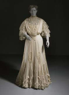 Circa 1904 Woman's Two-Piece Evening Gown United States.  Lace and silk bodice; silk crepe-backed satin skirt with lace and pressed cotton fiber bead trim. Via LACMA.