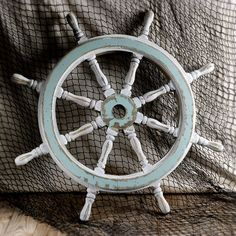 Take the helm!  A ship's wheel shows that you're taking control of your future ready to steer it in a new direction.  A life preserver may indicate you're floundering :).    You can buy both at the museum gift shop.  #nautical    http://maritimemuseum.novascotia.ca/