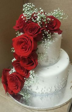 Calumet Bakery Two Tier Fondant with silver pearls and fresh red roses.
