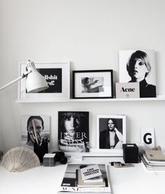 Perfect interior workspace. Black and white prints on shelves.