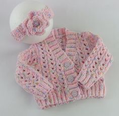 This adorable baby girls cardigan & headband set would make a lovely gift.  V Neck in Style with a pretty eylet lace design and button fastening to the front    Sized to fit a baby girl 3-6 Months Actual Measurements: Chest Size: 18in, Length: 9in, Underarm Seam: 6in    Knitted in Sirdar Tiny Tots Yarn  Completely machine washable at 40 degrees.      Parcels sent by 2nd Class Delivery in the UK.  Overseas Parcels will be sent by Airmail - please note this service does not give you a track...